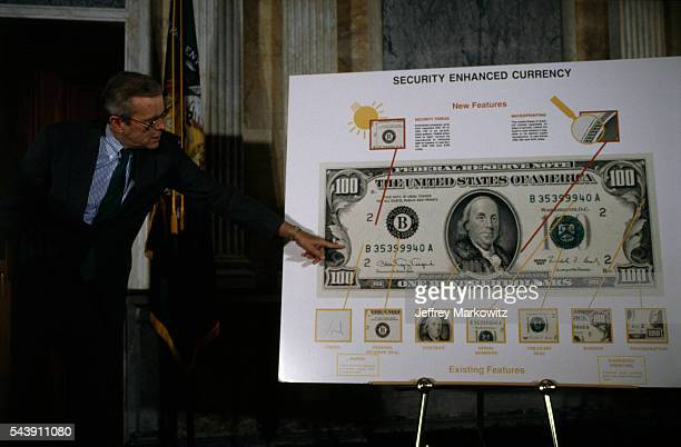 Secretary of the Treasury Nicholas Brady unveils a new bank bill with enhanced security from counterfeit