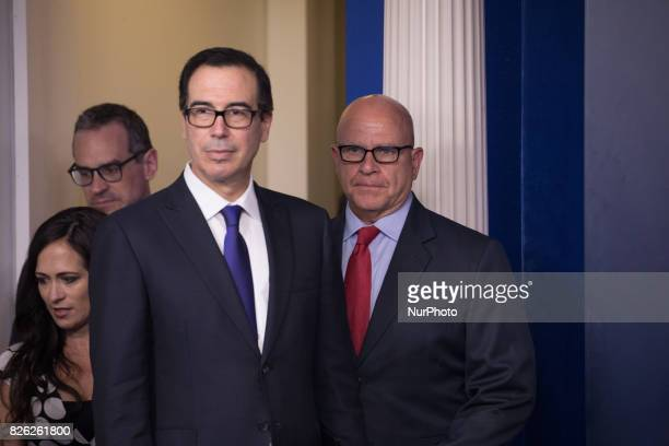 US Secretary of the Treasury Steven Mnuchin and US National Security Advisor H R McMaster enter the James S Brady Press Briefing Room of the White...