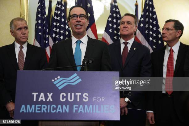 S Secretary of the Treasury Steven Mnuchin speaks as Sen Thom Tillis Sen David Perdue and Sen John Barrasso listen during a news conference on tax...