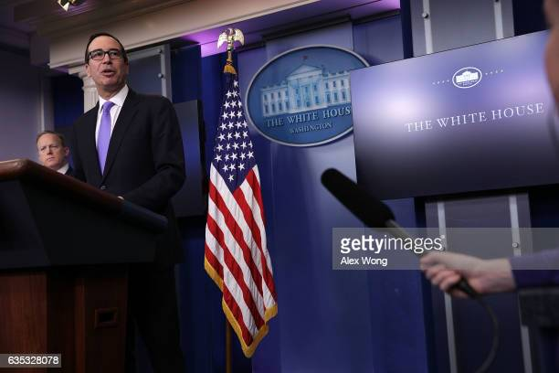 S Secretary of the Treasury Steven Mnuchin speaks as White House Press Secretary Sean Spicer looks on during the White House daily press briefing at...