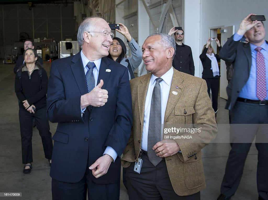 Secretary of the U.S. Department of the Interior Ken Salazar, left, and NASA Administrator Charles Bolden smile while watching the launch of the Landsat Data Continuity Mission (LDCM) spacecraft onboard a United Launch Alliance Atlas V rocket, February 11, 2013 at Vandenberg Air Force Base, California. The LDCM mission is a collaboration between NASA and the U.S. Geological Survey that will continue the Landsat Program's 40-year data record of monitoring the Earth's landscapes from space.