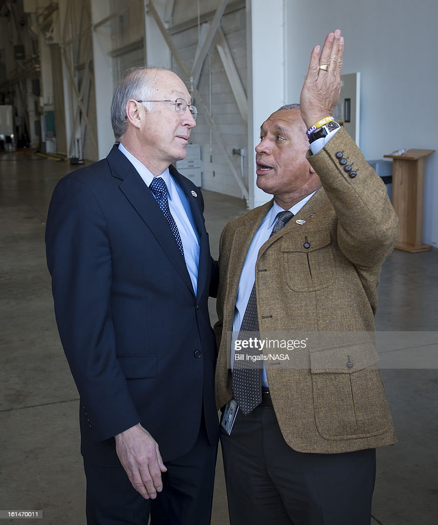 Secretary of the U.S. Department of the Interior Ken Salazar, left, and NASA Administrator Charles Bolden talk after the launch of the Landsat Data Continuity Mission (LDCM) spacecraft onboard a United Launch Alliance Atlas V rocket, February 11, 2013 at Vandenberg Air Force Base, California. The LDCM mission is a collaboration between NASA and the U.S. Geological Survey that will continue the Landsat Program's 40-year data record of monitoring the Earth's landscapes from space.