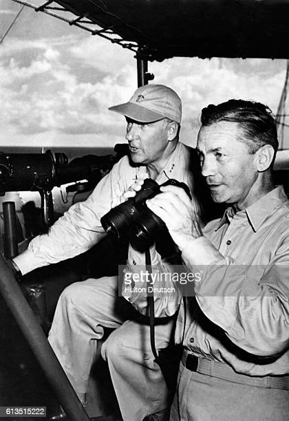 Secretary of the US Navy James Forrestal and Vice Admiral WHP Blandy commander of the joint ArmyNavy Task Force 1 watch the atom bomb explode over...