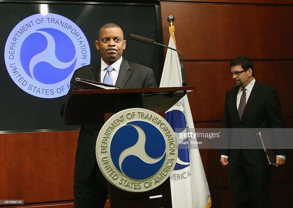 Secretary of Transportation <a gi-track='captionPersonalityLinkClicked' href=/galleries/search?phrase=Anthony+Foxx&family=editorial&specificpeople=7128225 ng-click='$event.stopPropagation()'>Anthony Foxx</a> (L) and Highway Traffic Safety Administrations Acting Administrator David Friedman walk into a news conference to announce that General Motors has agreed to pay a 35 million dollarcivil penalty, at the Department of Transportation, May 16, 2014 in Washington DC. Secretary Foxx said that GM violated federal safety laws in the Chevrolet Cobalt investigation.
