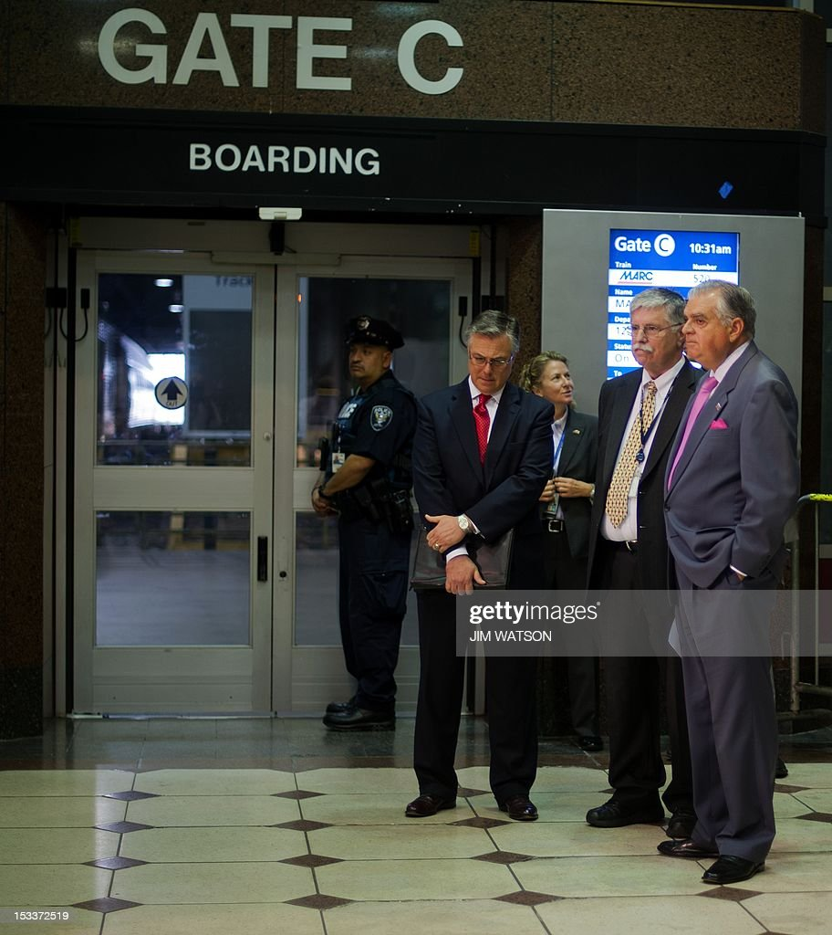 US Secretary of Transportation Ray LaHood (R) and AMtrak CEO and President Joseph Boardman (2nd R) await the arrival of the US Secretary of Homeland Security before announcing a partnership with Department of Homeland Security and the Department of Transportation to combat human trafficking on Amtrak trains during a press conference at Union Station in Washington, DC, October 4, 2012. AFP PHOTO/Jim WATSON