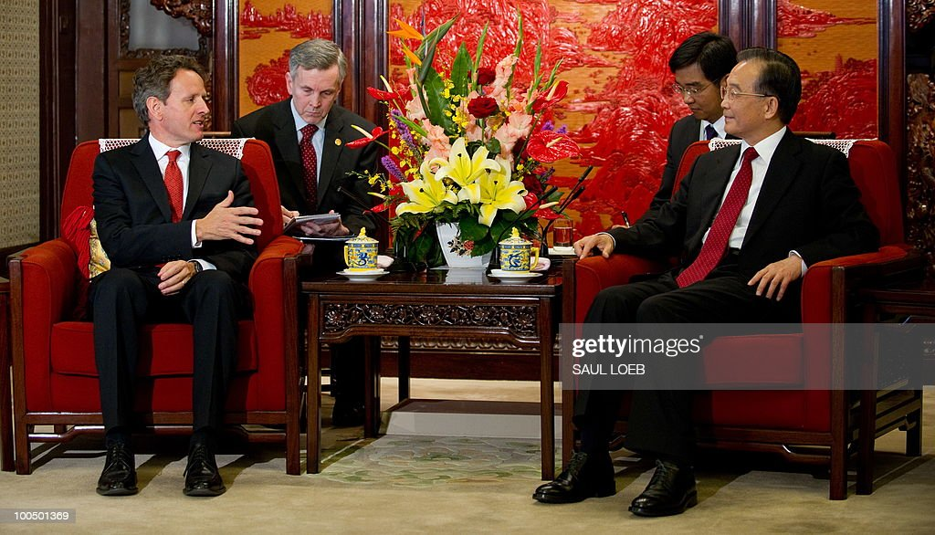 US Secretary of Treasury Timothy Geithner speaks during a meeting with Chinese Premier Wen Jibao (R) at Zhongnanahai Leadership Compound in Beijing, May 25, 2010. US Secretary of State Hillary Clinton said two days of high-level Sino-US talks had been 'very productive' but admitted differences remained, especially on economic and trade issues. AFP PHOTO / POOL / Saul LOEB