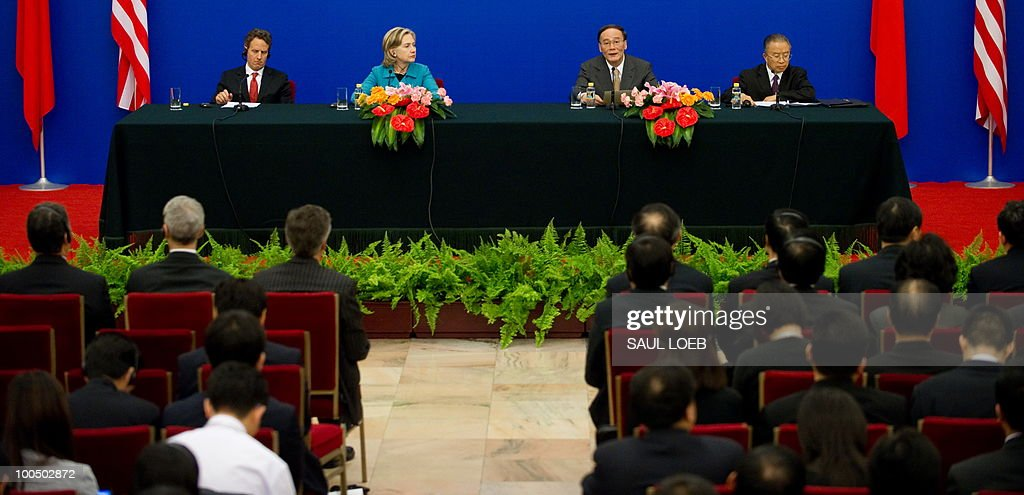 US Secretary of Treasury Timothy Geithner (L), US Secretary of State Hillary Clinton (2nd L), alongside Chinese State Councilor Dai Bingguo (R), listen as Chinese Vice-Premier Wang Qishan (2nd R) speaks during a signing ceremony at the conclusion of the Second Round of the US-China Strategic & Economic Dialogue in Beijing, May 25, 2010. US Secretary of State Hillary Clinton said two days of high-level Sino-US talks had been 'very productive' but admitted differences remained, especially on economic and trade issues. AFP PHOTO / POOL / Saul LOEB