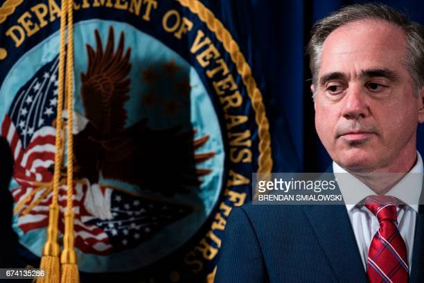 US Secretary of Veterans Affairs David J Shulkin listens before US President Donald Trump signs an executive order at the US Department of Veterans...