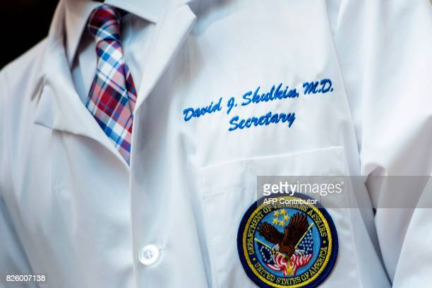 US Secretary of Veterans Affairs David J Shulkin listens while US President Donald Trump speaks about new technology used by the Department of...