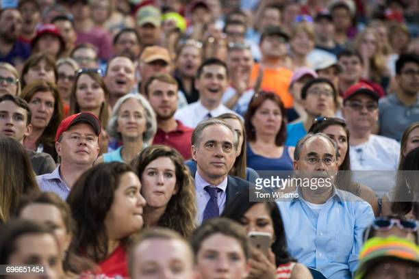 Secretary of Veterans Affairs David Shulkin center and Rep Bruce Poliquin RMaine sit with Republican fans during the 56th Congressional Baseball Game...
