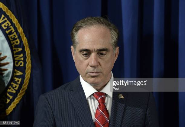 Secretary of Veterans Affairs David Shulkin listens to President Trump before signing an Executive Order on Improving Accountability and...