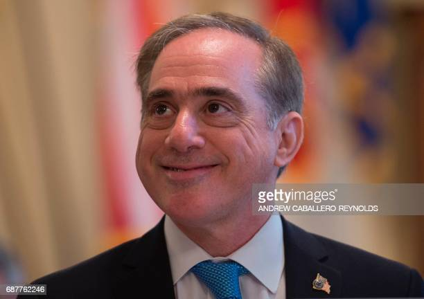 US Secretary of Veterans Affairs David Shulkin looks on before testifying at a House Veteran's Affairs Committee hearing on the FY2018 budget request...