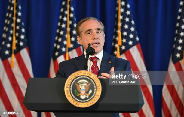 US Secretary of Veterans Affairs David Shulkin speaks before President Donald Trump signing the Veterans Affairs Choice and Quality Employment Act on...
