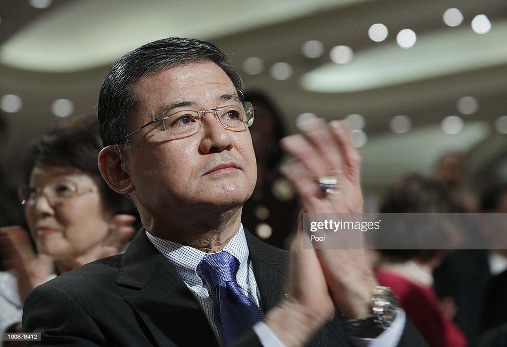 S Secretary of Veterans Affairs Eric Shinseki applauds during the National Prayer Breakfast at the Washington Hilton February 7 2013 in Washington DC...