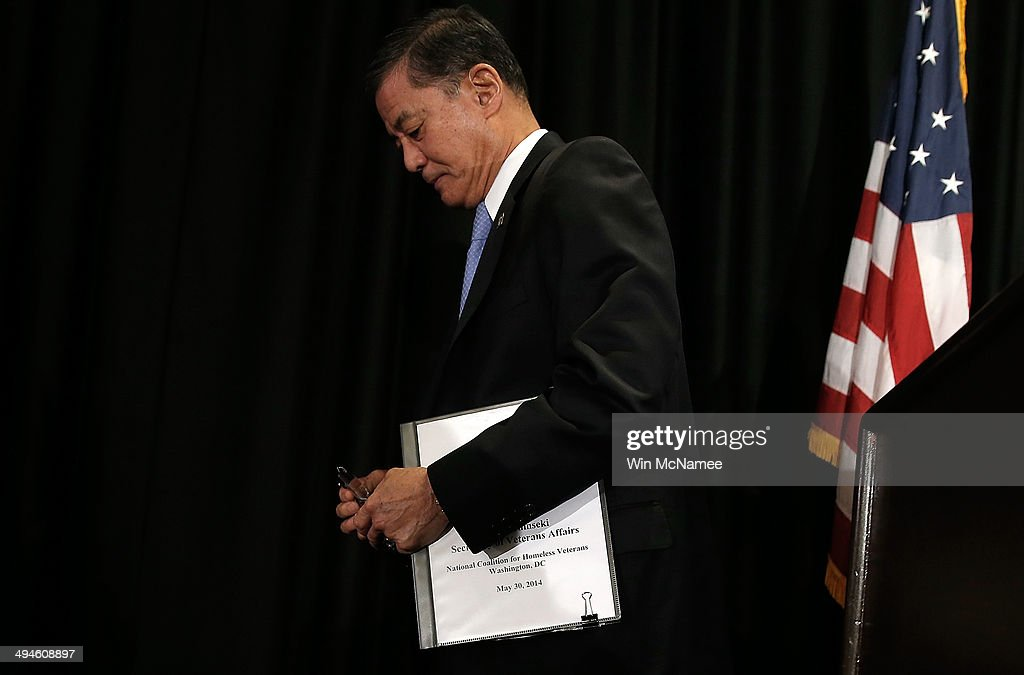 S Secretary of Veterans Affairs Eric Shinseki departs after addressing the National Coalition for Homeless Veterans May 30 2014 in Washington DC...