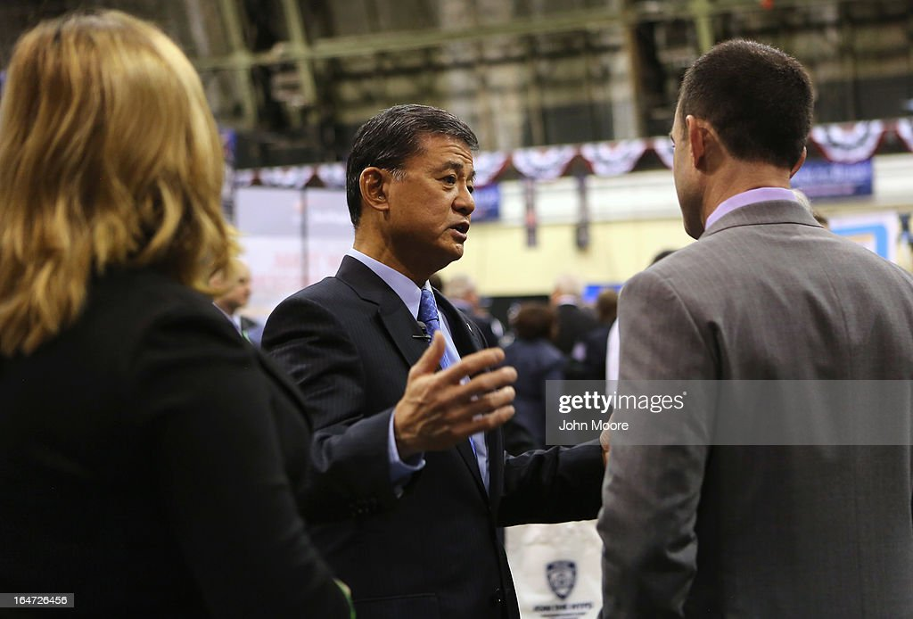 U.S. Secretary of Veterans Affairs <a gi-track='captionPersonalityLinkClicked' href=/galleries/search?phrase=Eric+Shinseki&family=editorial&specificpeople=2597806 ng-click='$event.stopPropagation()'>Eric Shinseki</a> (C) speaks with veterans at the Hiring Our Heroes job fair held on March 27, 2013 in New York City. Hundreds of U.S. military veterans and their spouses turned out to meet more than 100 employers participating at the second annual event, hosted by the U.S. Chamber of Commerce National Chamber Foundation. Lead sponsors were Capital One Financial Corporation and Toyota.