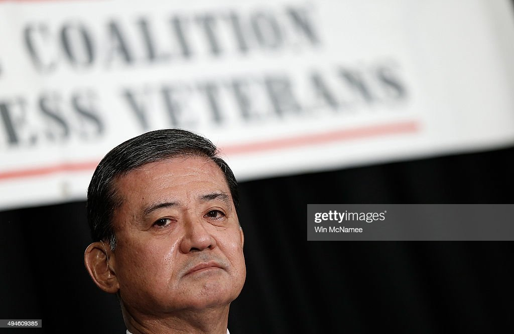 S Secretary of Veterans Affairs Eric Shinseki waits to address the National Coalition for Homeless Veterans May 30 2014 in Washington DC Shinseki is...