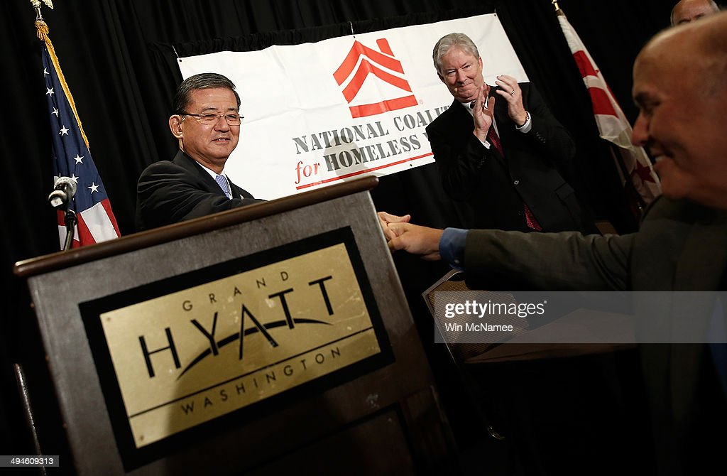 S Secretary of Veterans Affairs Eric Shinseki waves greets supporters before addressing the National Coalition for Homeless Veterans May 30 2014 in...