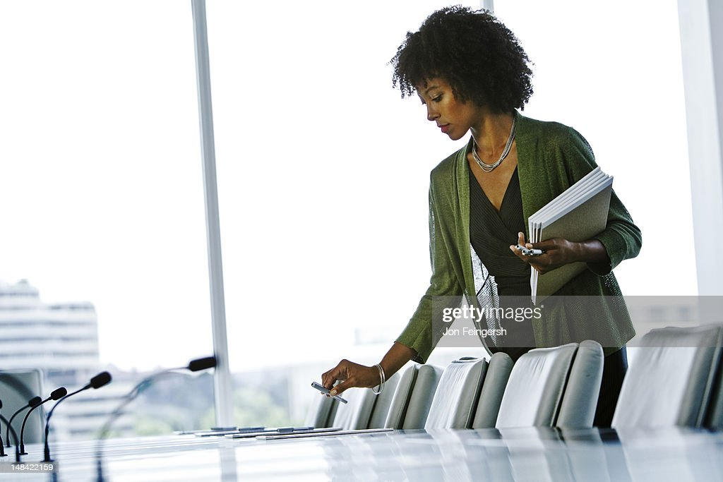 Secretary preparing board room