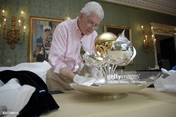 Secretary to the Trustees Christopher English unpacking the Principia a table fountain by Angela Connor Richard Fox part of the Silver Trust Downing...