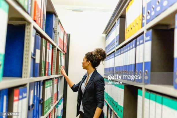 Secretary woman in basement archive