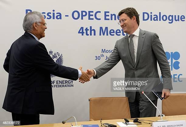 SecretaryGeneral Abdalla Salem ElBadri and Russia's Energy Minister Alexander Novak shake hands during a pressconference after RussiaOPEC energy...