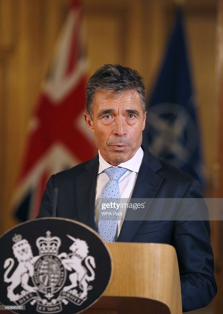 Secretary-General <a gi-track='captionPersonalityLinkClicked' href=/galleries/search?phrase=Anders+Fogh+Rasmussen&family=editorial&specificpeople=549374 ng-click='$event.stopPropagation()'>Anders Fogh Rasmussen</a> holds a joint news conference with Britain's Prime Minister David Cameron (not pictured) on Downing Street on June 19, 2014 in London, England. During his visit to the United Kingdom, the Secretary General will meet with British Prime Minister David Cameron, British Foreign Secretary William Hague and British Defence Secretary Philip Hammond in preparation for the 2014 NATO Summit in Wales.