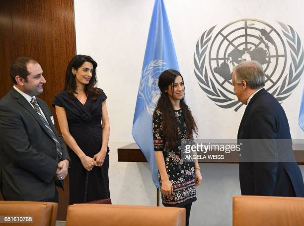 UN SecretaryGeneral Antonio Guterres and Nadia Murad speak as Amal Clooney looks on at the United Nations Headquarters on March 10 2017 in New York /...