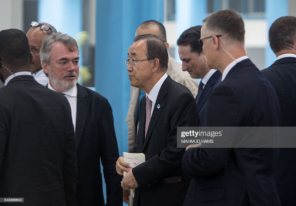 UN Secretary-General Ban Ki-moon (C) arrives for a press conference at a United Nations school in Gaza City on June 28, 2016. UN chief Ban Ki-moon the previous day urged Israelis and Palestinians not to allow extremists on either side to fan violence, as he arrived as part of a Middle East tour. HAMS