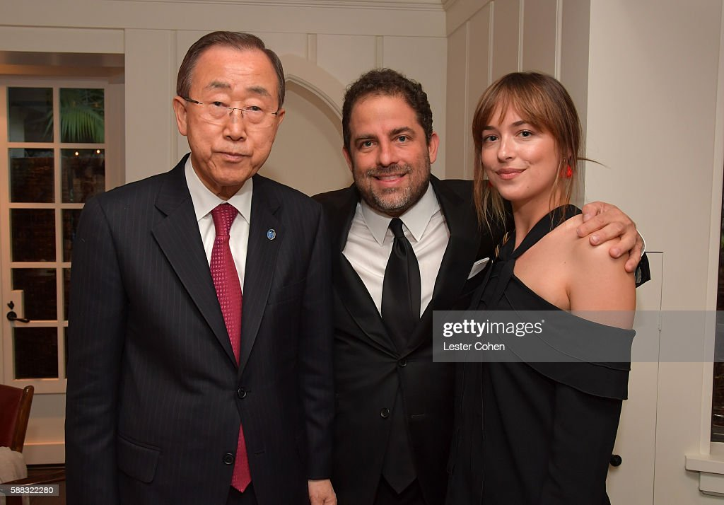 UN Secretary-General Ban Ki-moon, host Brett Ratner, and actress Dakota Johnson attend the special event for UN Secretary-General Ban Ki-moon hosted by Brett Ratner and David Raymond at Hilhaven Lodge on August 10, 2016 in Los Angeles, California.