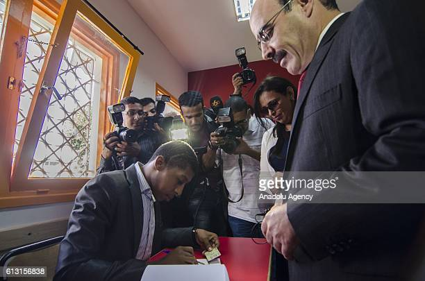 SecretaryGeneral Ilyas ElOmari of the Party of Authenticity and Modernity casts his vote at a polling station during the Parliamentary elections in...