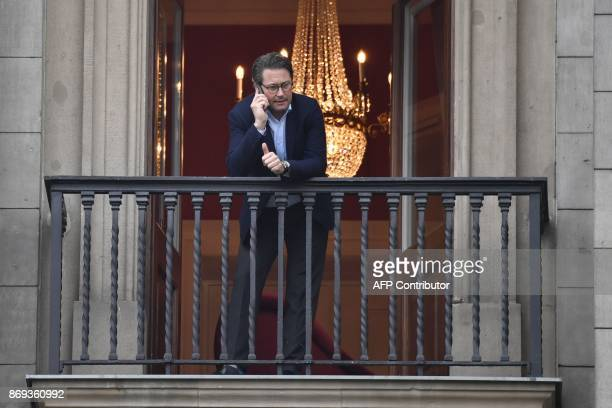 SecretaryGeneral of the Bavarian Christian Social Union party Andreas Scheuer phones on the balcony during a break of exploratory talks to form a new...