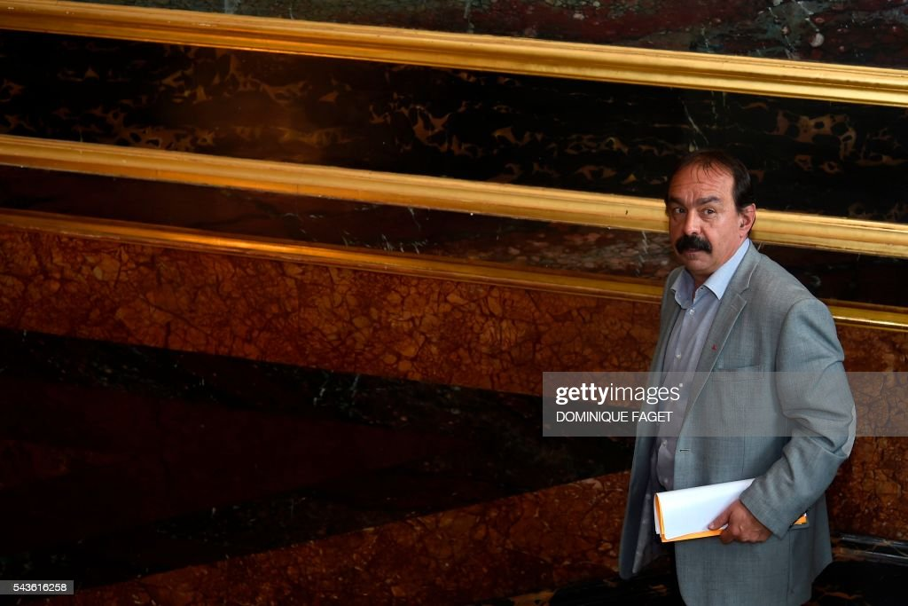Secretary-general of the French General Confederation of Labour (CGT) Philippe Martinez leaves the Hotel Matignon in Paris on June 29, 2016 after a meeting on the Socialist government's labour reforms with French Prime minister and French Labour minister. / AFP / DOMINIQUE