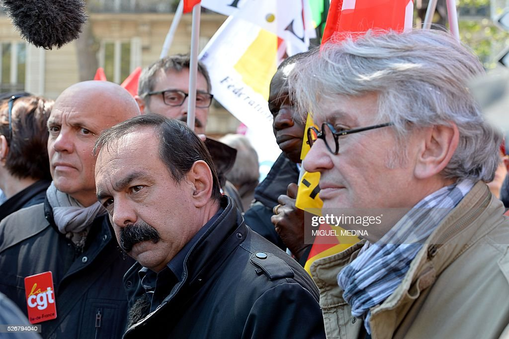 Secretary-general of the General Confederation of Labour (CGT) French worker's union Philippe Martinez (L) and secretary-general of Force Ouvriere (FO) French worker's union Jean-Claude Mailly (R) attend a traditional May Day demonstration on May 1, 2016, in Paris.