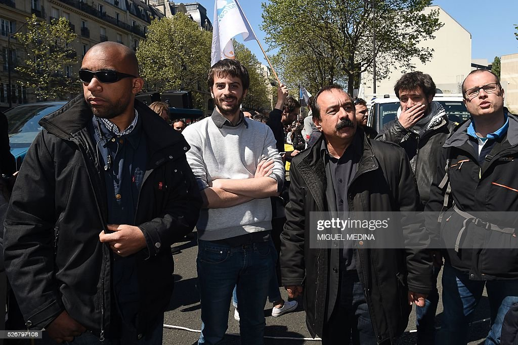 Secretary-general of the General Confederation of Labour (CGT) French worker's union Philippe Martinez (3rd R) and president of the National Student's Union of France (UNEF) William Martinet (2nd L) attend a traditional May Day demonstration on May 1, 2016, in Paris.