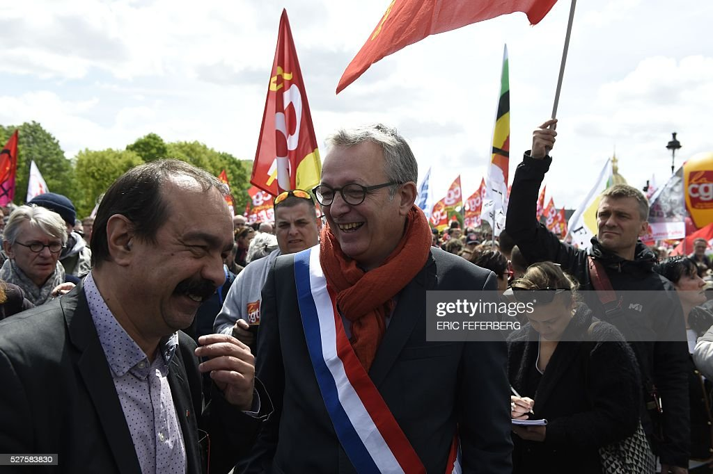Secretary-general of the General Confederation of Labour (CGT) French worker's union Philippe Martinez (L) speaks with French Communist Party (PCF) General Secretary and Party of the European Left (EL) president Pierre Laurent during a demonstration against the government's planned labour law reforms on May 3, 2016, in Paris as French lawmakers begin to examine the contested labour reform bill at the Parliament. Unions fear it will erode the cherished rights of workers on full-time contracts, while student organisations -- who have been at the forefront of the protests -- believe it will fail to create 'real' jobs for young people.