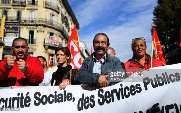 SecretaryGeneral of the General Confederation of Labour French worker's union Philippe Martinez stands behind a banner during a demonstration in...