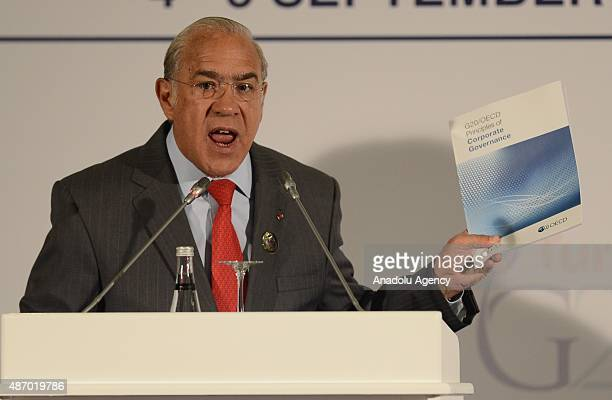 SecretaryGeneral of the Organisation for Economic Cooperation and Development Angel Gurria delivers a speech during a press conference held to...