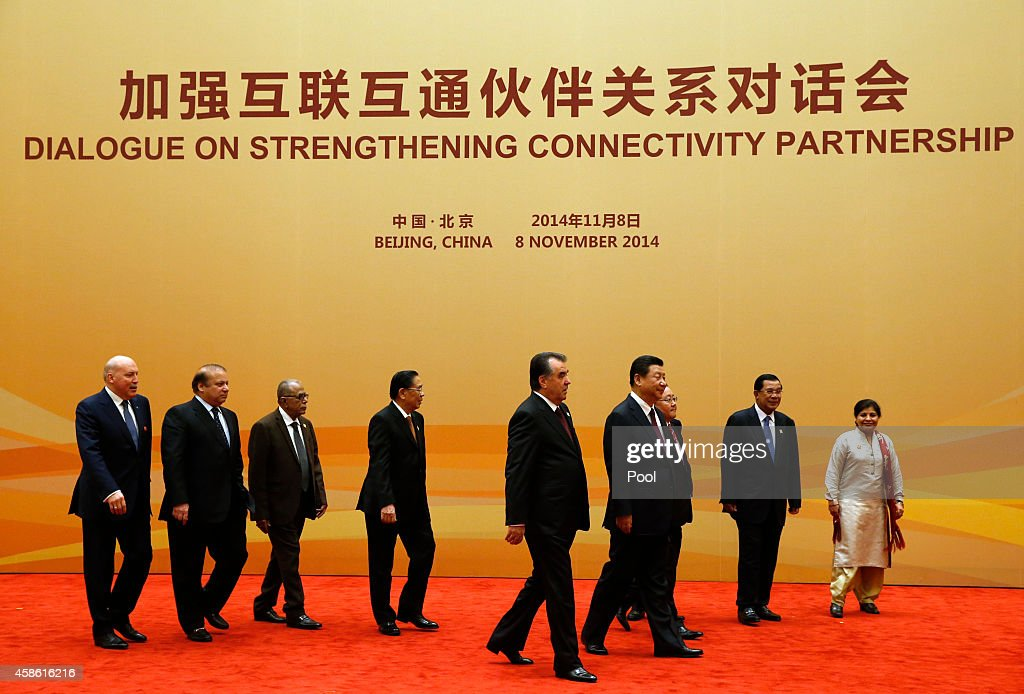 Secretary-General of the Shanghai Cooperation Organization (SCO) Dmitry Mezentsev, Pakistan's Prime Minister <a gi-track='captionPersonalityLinkClicked' href=/galleries/search?phrase=Nawaz+Sharif&family=editorial&specificpeople=217726 ng-click='$event.stopPropagation()'>Nawaz Sharif</a>, Bangladesh's President Abdul Hamid, Laos' President <a gi-track='captionPersonalityLinkClicked' href=/galleries/search?phrase=Choummaly+Sayasone&family=editorial&specificpeople=556173 ng-click='$event.stopPropagation()'>Choummaly Sayasone</a>, Tajikistan's President Emomali Rahmon, China's President <a gi-track='captionPersonalityLinkClicked' href=/galleries/search?phrase=Xi+Jinping&family=editorial&specificpeople=2598986 ng-click='$event.stopPropagation()'>Xi Jinping</a>, Mongolia's President <a gi-track='captionPersonalityLinkClicked' href=/galleries/search?phrase=Tsakhiagiin+Elbegdorj&family=editorial&specificpeople=5427078 ng-click='$event.stopPropagation()'>Tsakhiagiin Elbegdorj</a>, Cambodia's Prime Minister <a gi-track='captionPersonalityLinkClicked' href=/galleries/search?phrase=Hun+Sen&family=editorial&specificpeople=224084 ng-click='$event.stopPropagation()'>Hun Sen</a> and the executive secretary of the United Nations Economic and Social Commission for Asia and the Pacific Shamshad Akhtar (L-R) head to their meeting room for the DialogueO n Strengthening Connectivity Partnership at the Diaoyutai State Guesthouse on November 8, 2014 in Beijing, China.