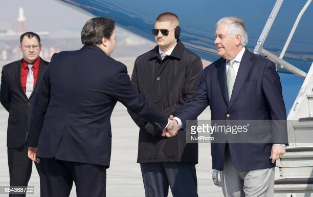 US Secretay of State Rex Tillerson and Charge d'Affairs ad interim Marc Knapper shakes hand greet at military Osan airbase in South Korea Twoday...
