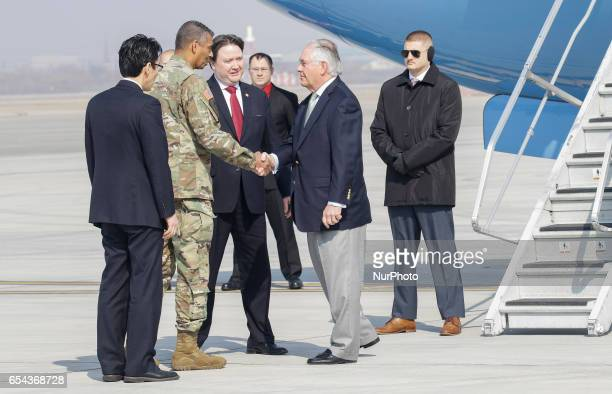 US Secretay of State Rex Tillerson and Gen Vincent K Brooks shakes hand greet at military Osan airbase in South Korea Twoday visit aimed at...
