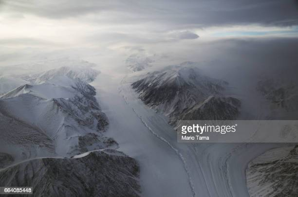 A section of a glacier is seen from NASA's Operation IceBridge research aircraft on March 29 2017 above Ellesmere Island Canada The ice fields of...