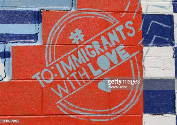 A section of a mural that is part of the #ToImmigrantsWithLove campaign on Paris Street in East Boston is pictured on Oct 19 2017 A host of efforts...