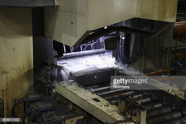 A section of aluminium is cooled with water as it passes along the aluminium rolling mill at the Ras Al Khair Industrial City operated by the Saudi...