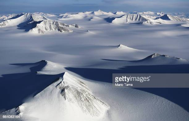 A section of an ice field is seen from NASA's Operation IceBridge research aircraft on March 29 2017 above Ellesmere Island Canada The ice fields of...