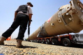 A section of an oil refinery is brought on a lorry to the Kawergosk Refinery some 20 kilometres east of Arbil the capital of the autonomous Kurdish...