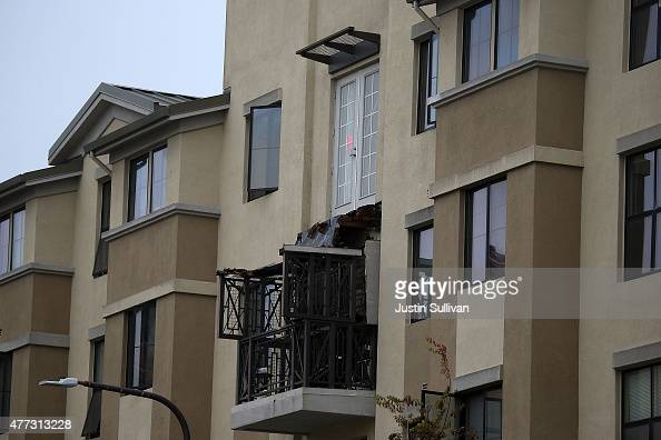 A section of collapsed balcony remains on the front of an apartment building new UC Berkeley on June 16 2015 in Berkeley California 5 people were...