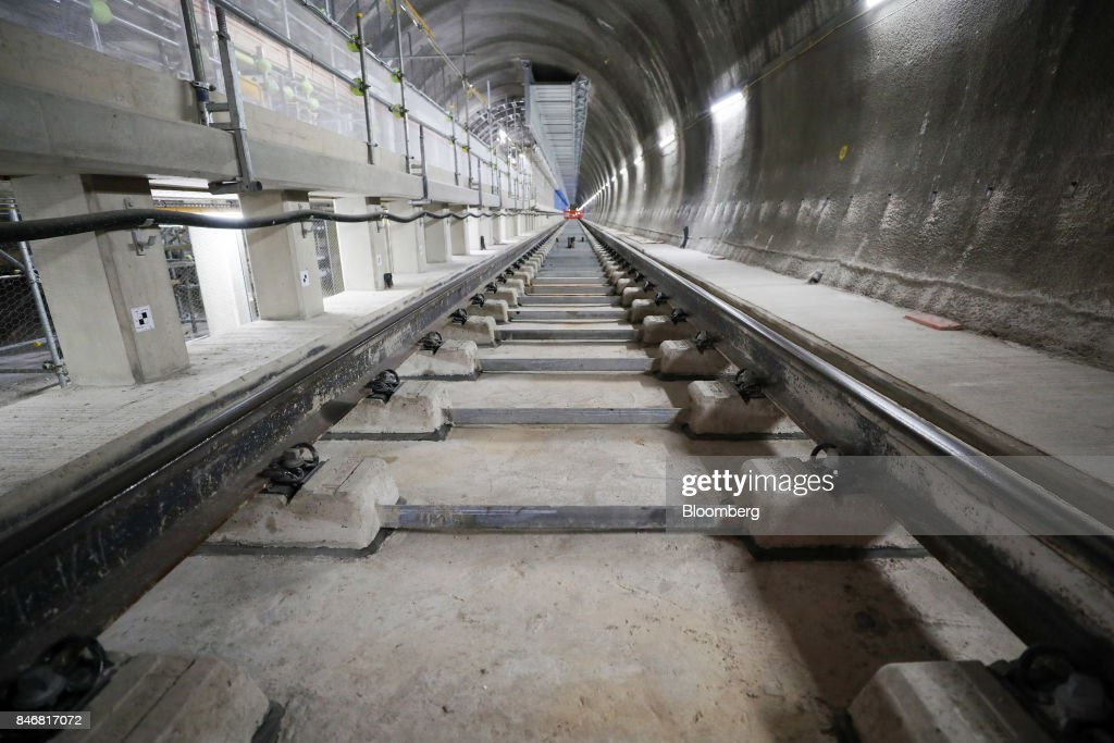 A section of Crossrail Ltd. track passes through a tunnel near Whitechapel station during an event to celebrate the completion of the permanent track on the Elizabeth line in London, U.K., on Thursday, Sept. 14, 2017. Crossrail, which will be known as the Elizabeth Line once its up and running, hasnt yet set fares, but transit agency Transport for London has indicated they will be significantly less than Heathrow Express with a charging structure more akin to the Tube. Photographer: Chris Ratcliffe/Bloomberg via Getty Images