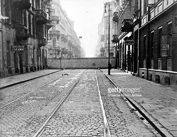 Section of eightfoot high concrete wall encircling Jewish ghetto in Warsaw Poland