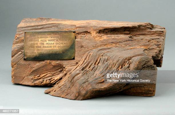 Section of hollow log with rectangular metal plaque inscribed 'A PIECE OF THE 'TREATY OAK'/UNDER WHICH/THOMAS PELL MADE A TREATY/WITH THE INDIAN...